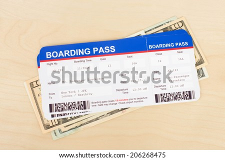 Boarding pass and dollar banknote concept for travel expenses - stock photo