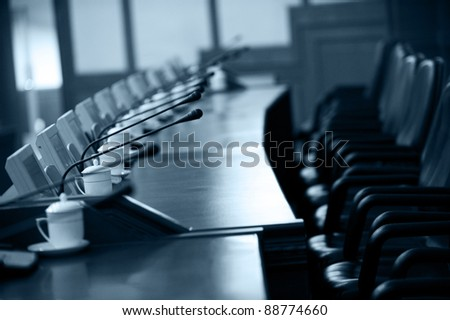 boardroom with chairs and intercom system - stock photo