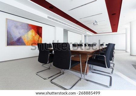Boardroom with long table in the business centre - stock photo