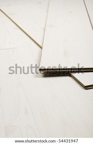 Boards of white laminate flooring ,vertical image