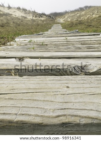 Boardwalk across dunes, low angle view, at Back Bay National Wildlife Refuge, Virginia Beach, USA - stock photo