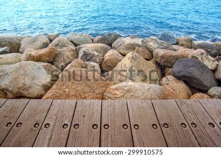 Boardwalk and Rocks At Seashore, Natural Background - stock photo