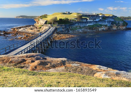 Boardwalk bridge to Bare Island, near Sydney, Australia.  Abundant marine life and underwater reefs, caves, canyons make it the most popular with divers and also fisherman - stock photo