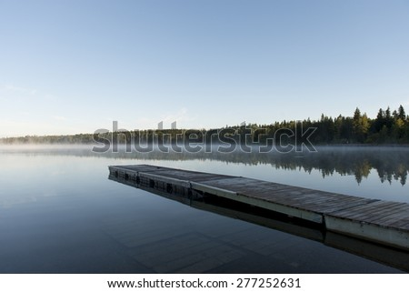 Boardwalk in a lake, Riding Mountain National Park, Manitoba, Canada