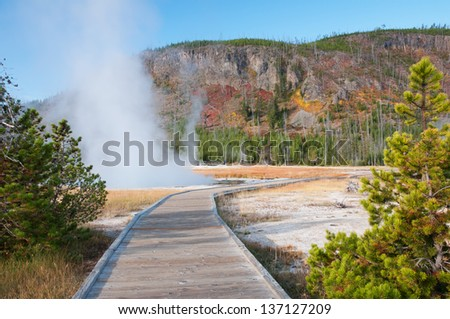 Boardwalk in the Black Sand Basin of Yellowstone National Park, Wyoming. - stock photo