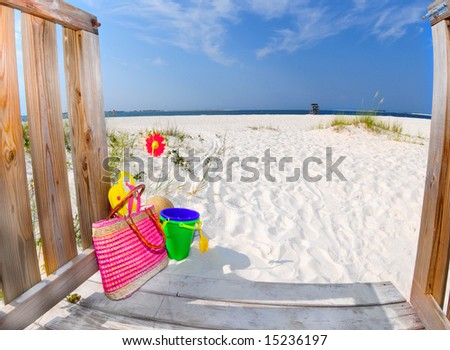 Boardwalk leading to beautiful beach with colorful accessories
