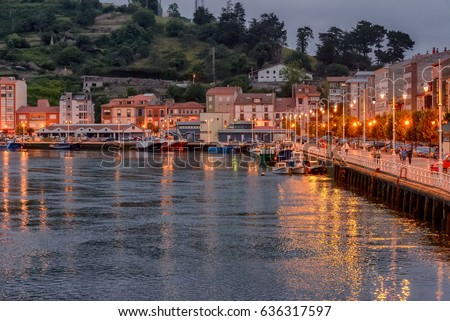 Boardwalk Night Lights And Reflection In The Water In Coastal Village Of  Ribadesella, Asturias,