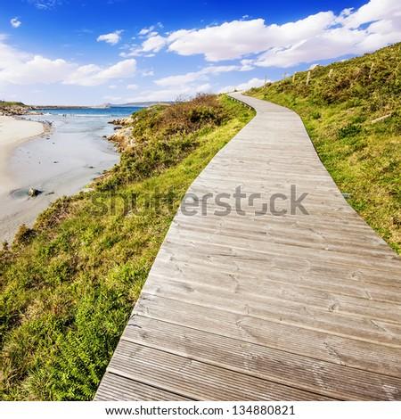 Boardwalk on the beach in Muxia, La Coruna (Galicia), Spain - stock photo