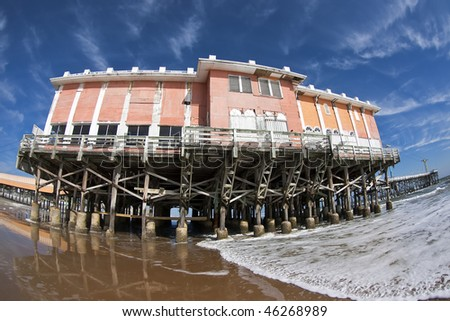 Boardwalk pier on the beach in Daytona Beach, FL. - stock photo