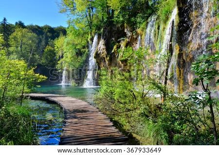Boardwalk through the waterfalls of Plitvice Lakes National Park, Croatia - stock photo