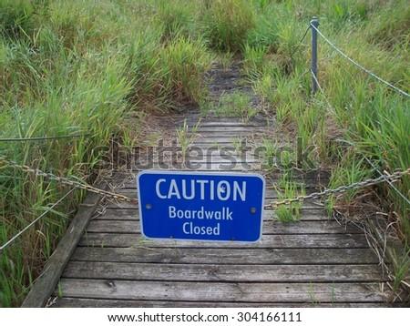 Boardwalk Through The Wetland - stock photo