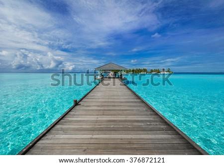 Boardwalk to paradise in Bora Bora - stock photo