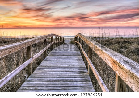Boardwalk to Sunrise - stock photo