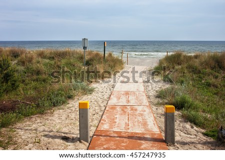 Boardwalk to the beach at Baltic Sea in Jastarnia, small resort town on Hel Peninsula in Poland, Europe - stock photo
