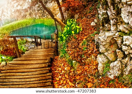 Boardwalk with autumn view - stock photo