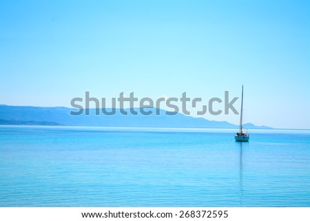 boat alone in the sea on a clear summer day - stock photo