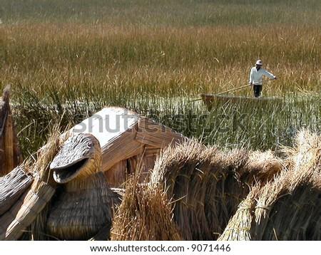 Boat among the reeds.  Floating islands.  Lake Titicaca.  Peru. - stock photo