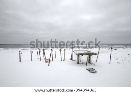 "Boat anchor covered with snow. Russia, Arkhangelsk region, ""Onega Pomorie"" National Park"