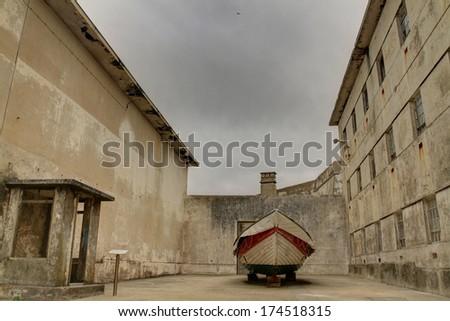 "Boat anchored in the ""Forte de Peniche"" jail, Portugal (HDR photo) - stock photo"