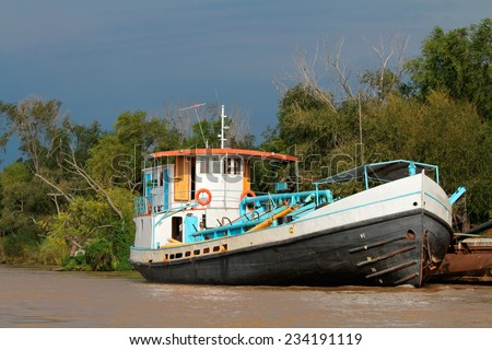Boat anchored on the banks of the parana river, Rosario, Argentina