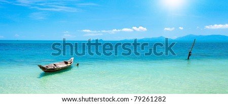boat and beautiful blue ocean - stock photo
