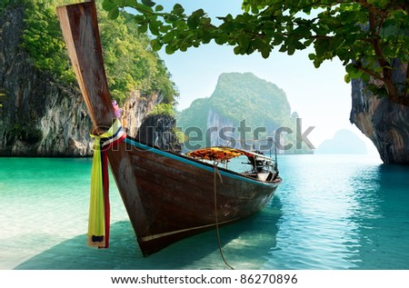 boat and islands in andaman sea Thailand - stock photo
