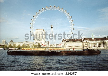 boat and London Eye on Thames River in London - stock photo