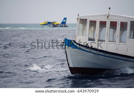 Boat and plane on the background