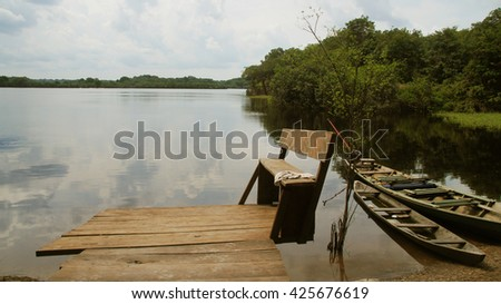 Boat and River at rain forest in Amazonas, Brazil - stock photo
