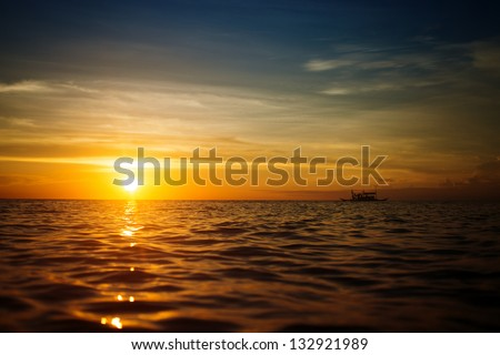 Boat and sunset - stock photo