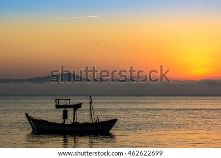 Boat and sunset.