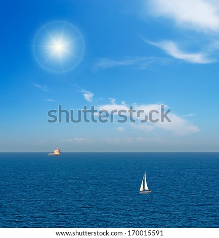 boat and tanker on a clear day - stock photo