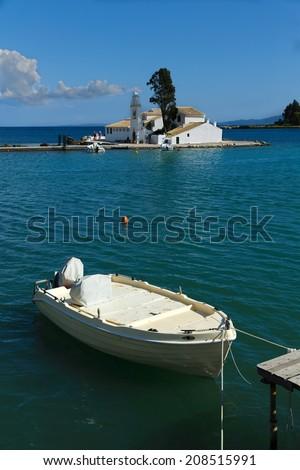 Boat and Vlacherna monastery, Kanoni, Corfu, Greece  - stock photo