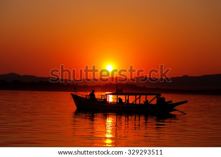 Boat at Inle Lake at sunset