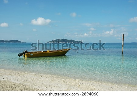 boat at sea side with clear water and blue sky