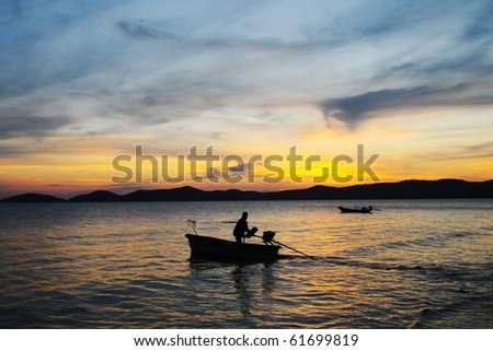 Boat at sunset. - stock photo
