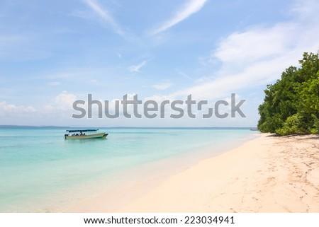 Boat at the beach of Zapatilla island, archipelago Bocas del Toro, Panama - stock photo
