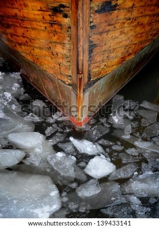 Boat bow through ice flakes - icebreaker - stock photo