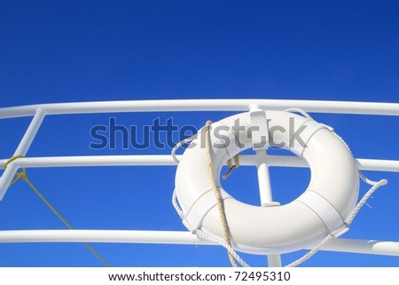 boat buoy white hanged in railing summer vacation blue sky - stock photo