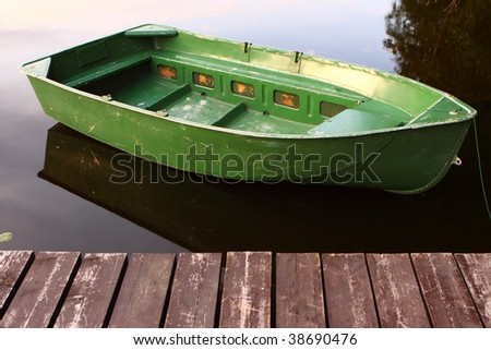 boat by the pier - stock photo