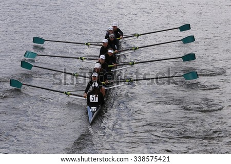 Boat Club BOSTON - OCTOBER 18, 2015: Whitemarsh  races in the Head of Charles Regatta Women's Youth Eights [PUBLIC RACE] - stock photo