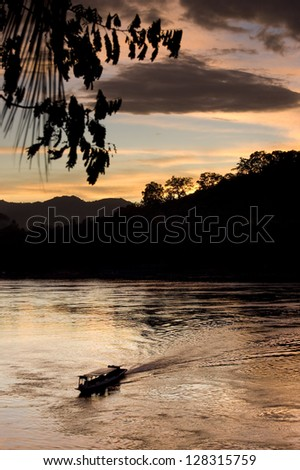 boat crossing a river - stock photo