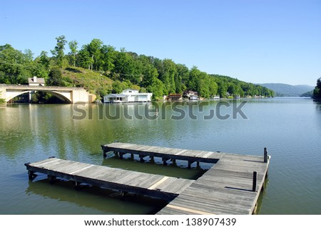 boat dock at Lake Lure in North Carolina with lakefront homes