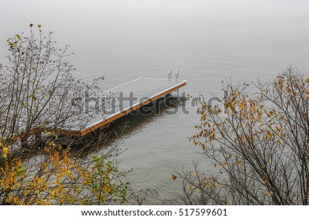 Boat dock on foggy day on Coeur d'Alene Lake in Idaho.