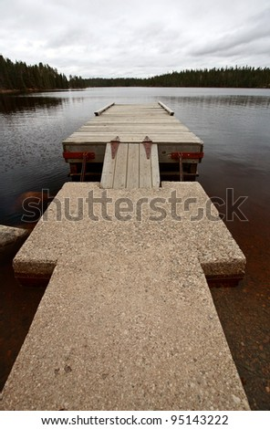 Boat dock on Northern Manitoba lake - stock photo