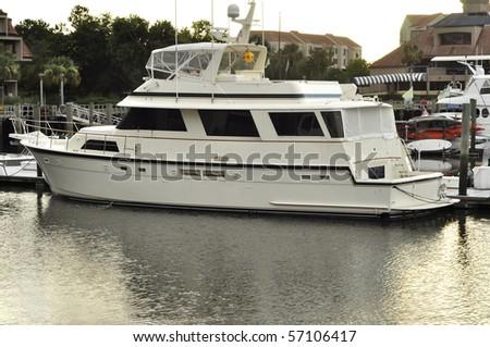 Boat docked in Shelter Cove Marina on Hilton Head Island, South Carolina. - stock photo