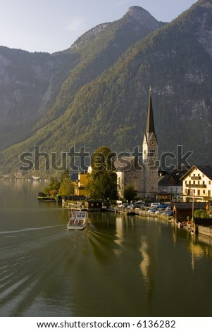 Boat docking in the morning haze, Hallstatt, Austria - stock photo