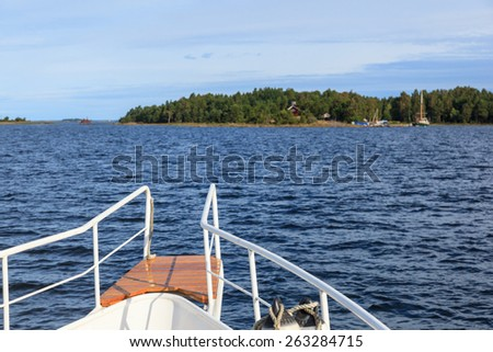 Boat entering the islands in the sea archipelago - stock photo
