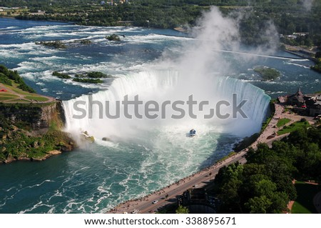 Boat entering the mist of Niagara Falls - stock photo