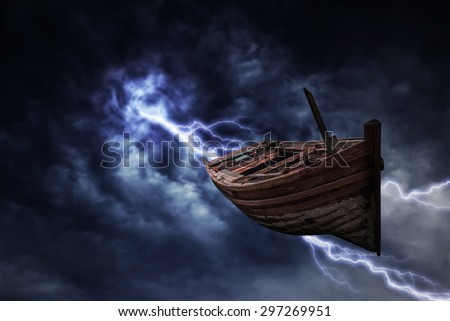 Boat falls from the sky, with the storm. - stock photo